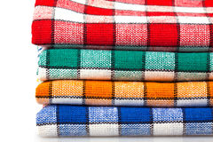 Four colored dishcloths isolated Stock Photo