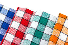 Four colored dishcloths isolated Stock Images