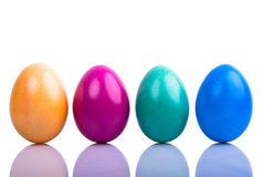 Four colored Easter eggs V1. Four colored Easter eggs are on a white background with text space Stock Photography