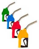 Four Colored Gasoline Fuel Pump Nozzles Stock Photography