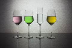 Four Colored Glasses of Water Stock Photo