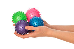 Four colored massage balls Royalty Free Stock Photos