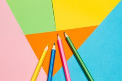 Colored pencils on colored backgrounds royalty free stock photos