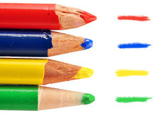 Four colored pencils. Childhood memories: fun colored pencil and doodle macro with focus on the tip Stock Photography