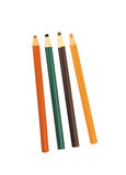 Four colored pencils across white stock photography