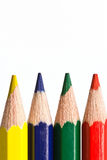 Four colored pencils macro Stock Photography