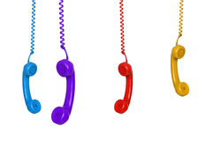 Four colored phones hanging Royalty Free Stock Image
