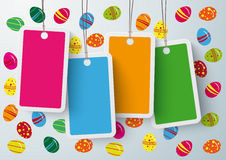 Four Colored Price Sticker Easter Eggs. Four colored price stickers on the grey background Stock Image