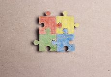 Four colored puzzle pieces. Autism Awareness Day. Autism Spectrum Disorder ASD concept stock photo