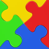 Four colored puzzle pieces close up. Four colored puzzle pieces assemled close up as concept for cooperation, group job, integration Royalty Free Stock Photos
