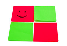 Four colored stickers. One with paited smile Royalty Free Stock Photography