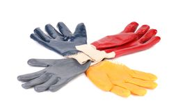 Four colores of rubber gloves. Stock Photos