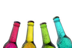 Four colorful bottles with sparkling liquid Royalty Free Stock Photography