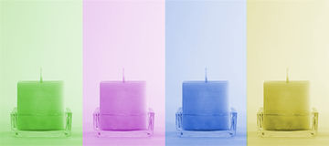 Four colorful candles Stock Photos