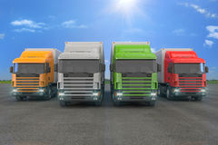 Four colorful cargo trucks parked in a row Stock Photography