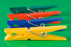 Four colorful clothespins Stock Photos