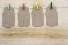 Four colorful clothespins on the rope with notes Stock Photography