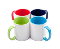 Four colorful cups Stock Image