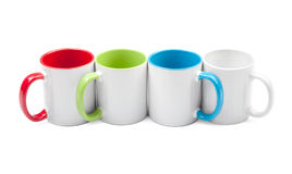 Four colorful cups in a row Royalty Free Stock Images