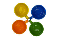 Four colorful cups, top view Royalty Free Stock Photo