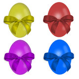 Four colorful Easter eggs with bows decorated Royalty Free Stock Photos