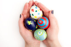Four Colorful Easter Eggs in the Hand Stock Photo