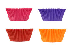 Four colorful empty muffin cups Stock Images