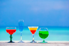 Four colorful exotic tasty cocktails background Stock Image