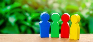 Four colorful figures of people talking. The concept of cooperation and mutual assistance. International cooperation, joint stock photo