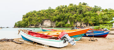 Four Colorful Fishing Boats on Beach Royalty Free Stock Images