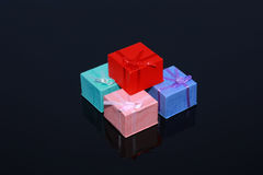 Four colorful gift boxes isolated on black Stock Photos