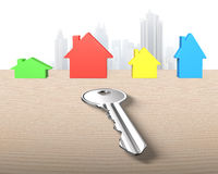 Four colorful houses and one silver key Royalty Free Stock Photography