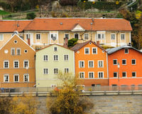 Four colorful houses in a row with different rooflines along the Royalty Free Stock Photos