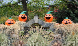 Four colorful jack-o-lanterns Royalty Free Stock Photography