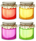 Four colorful jars that are  tightly covered Royalty Free Stock Photo