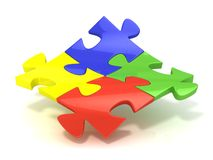 Four colorful jigsaw puzzle pieces banded Royalty Free Stock Images