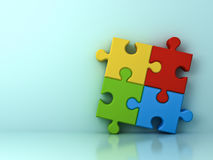 Four colorful jigsaw puzzle pieces concept on cyan wall background. With shadow and reflection . 3D rendering Stock Image