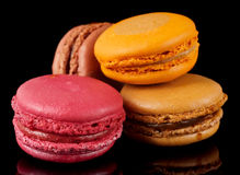 Four colorful macarons on black background Stock Photo