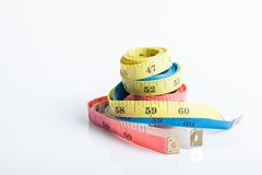 Four colorful  measuring tapes Stock Images