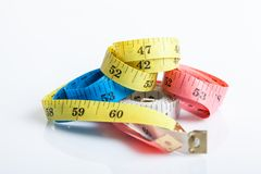 Four colorful  measuring tapes Stock Photo