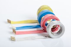 Four colorful  measuring tapes Stock Photos