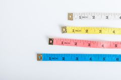 Four colorful  measuring tapes Royalty Free Stock Photography