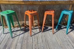 Four Colorful metal bar stools Stock Photography