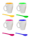 Four colorful mugs and four colorful spoons Stock Photo