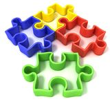Four colorful outlined jigsaw puzzle pieces Royalty Free Stock Image