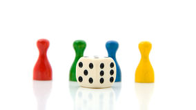 Four colorful pawns with white dice Royalty Free Stock Image