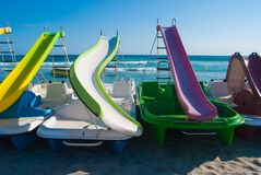 Four colorful pedalos and blue sky stock image