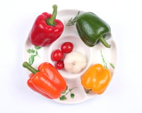 Four colorful peppers Stock Photos