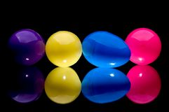 Four colorful plastic Easter eggs Stock Images