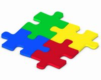 Four colorful puzzles Stock Photos